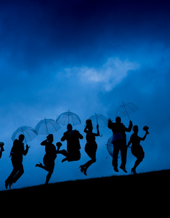 stormy sky sillouette of bridal party group for wedding photography