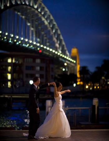 Wedding Photography night image of couple under harbour bridge