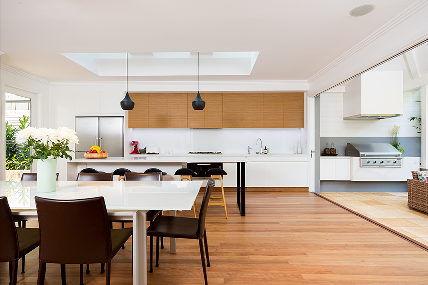 straight on architectural photography of kitchen and dining area