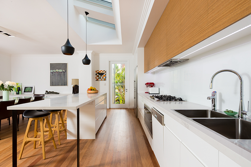Interiors photographer uses straight on image stlye for kitchen photograph