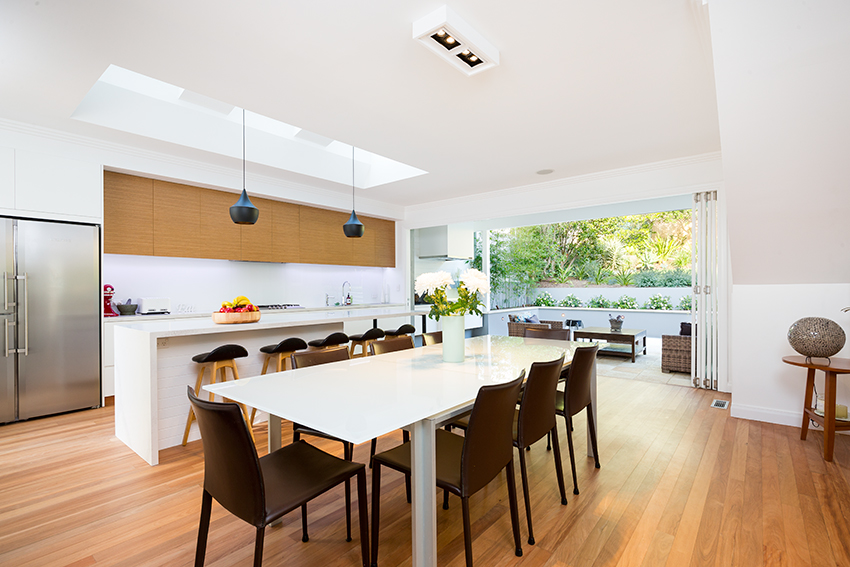 wide image of dning and kitchen area by Interiors photographer Adam Firth