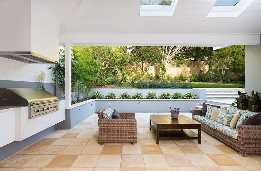 Interiors photographer melds outside entertaining area with lawn area into one image using photographic lighting