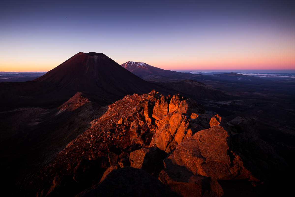 photographs of Mount Ruapehu and Ngauruhoe at sunrise