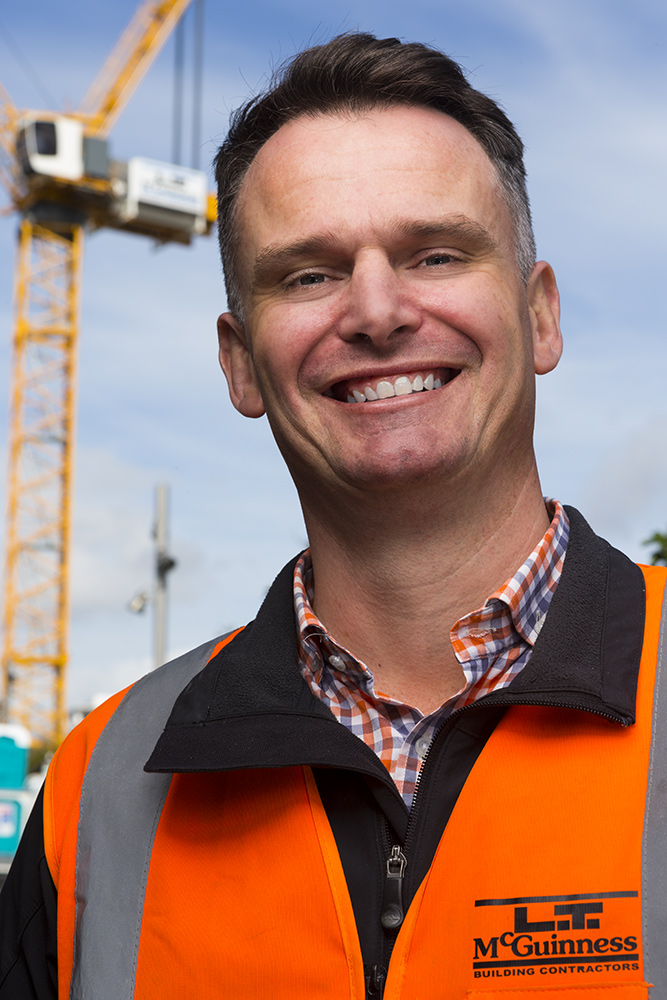 construction staff portraits with crane in background