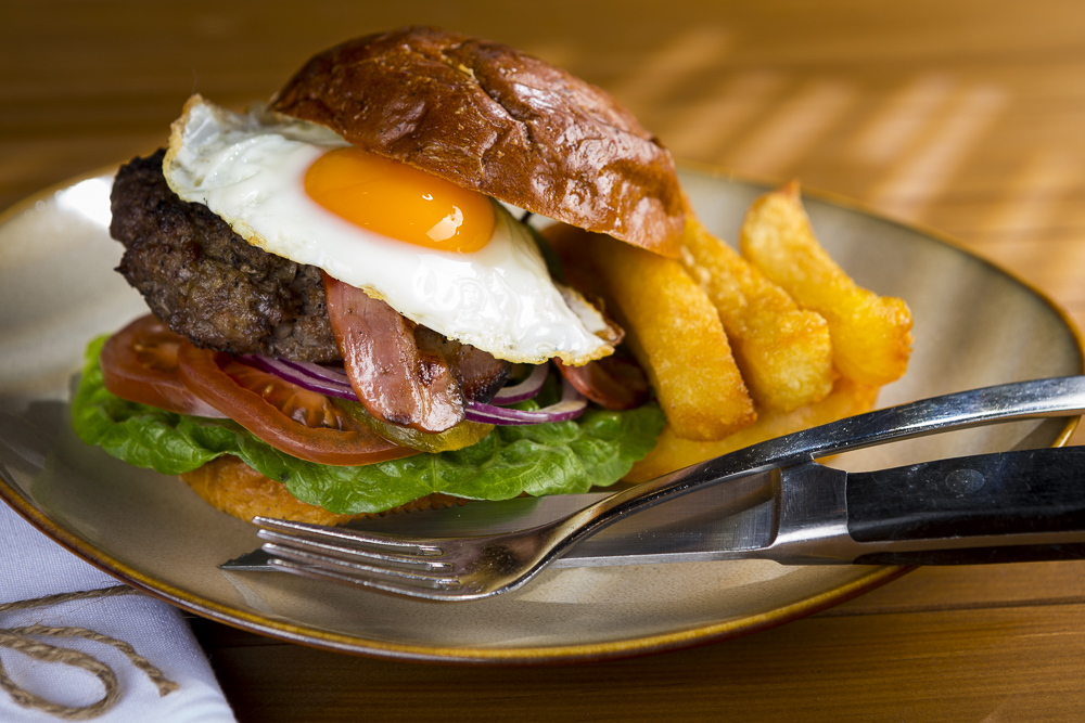 bacon beef and egg burger photographed for Rydges Hotel restaurant the cut