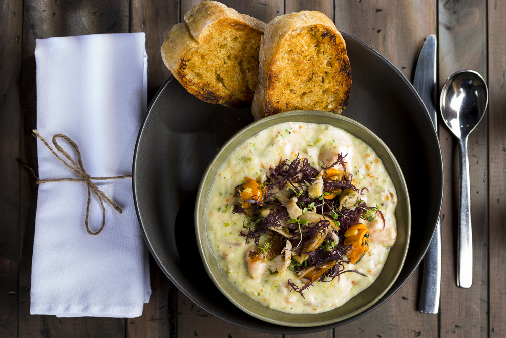 hotel food photography of seafood chowder
