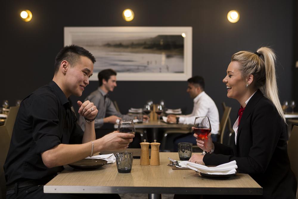 image of couple having dinner taken in hotel restaurant for image library