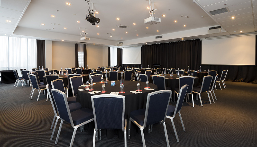 large function room set up as convention layout for hotel photography