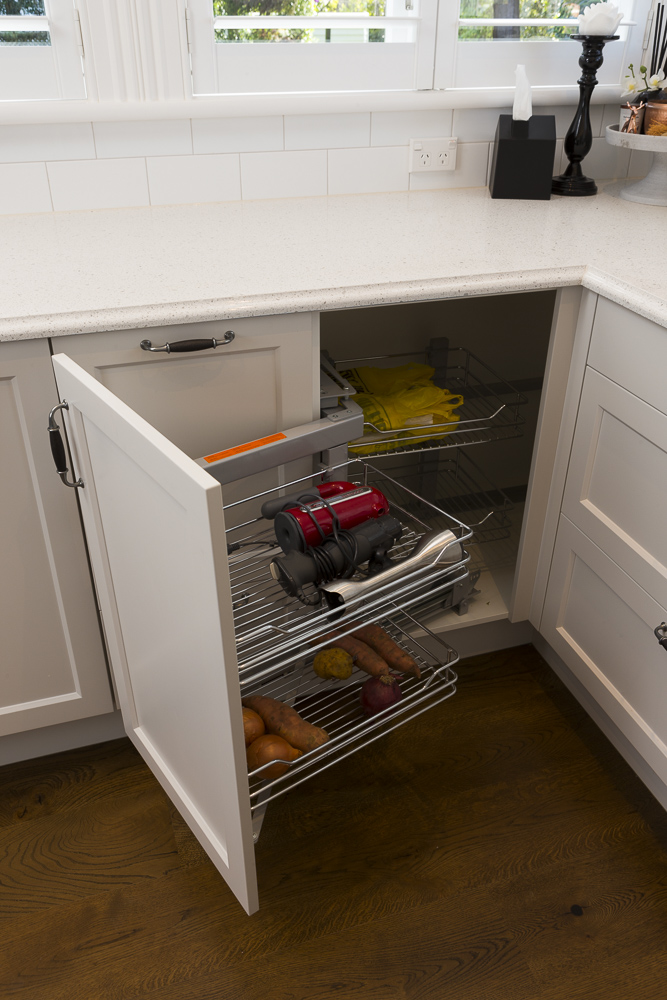 kitchen photography of clever fold away deep cupboards