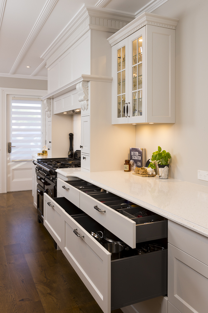 Images of kitchen drawers in Auckland kitchen by interiors photographer Adam Firth