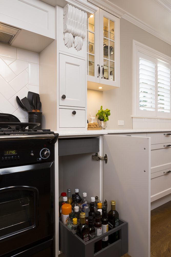 kitchen photography showing roll out oil storage