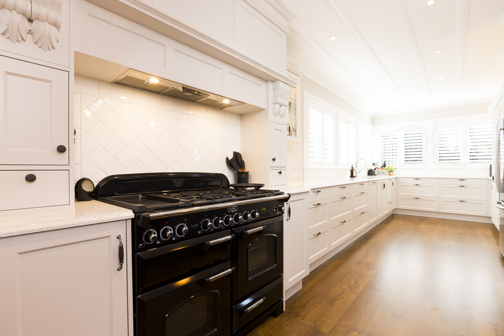 kitchen photography of white kitchen and black oven